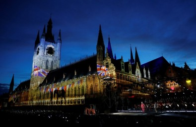"During the ""The Festival Of Remembrance"" broadcast, each person in the show—whether speaking or singing—had  a headset mic and a backup lavalier microphone that needed to be managed, live. Here a warhorse image is projected onto Ypres cathedral during the Last Post ceremony at the Menin Gate. Image: Darren Staples/Reuters."