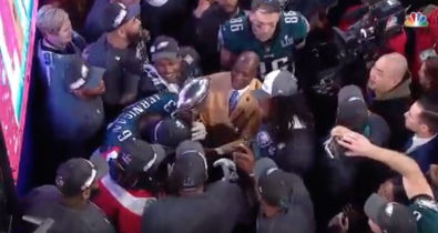 That's Germond at the top right corner of the photo, captured live during NBC's Super Bowl telecast as he pushed through the crowd with his Steadicam rig.