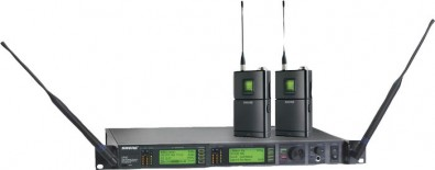 The Shure UR14D Wireless Dual Channel Receiver (shown with Two UR1 Bodypack Transmitters) features advanced track tuning that shifts the RF filter along with the selected frequency.