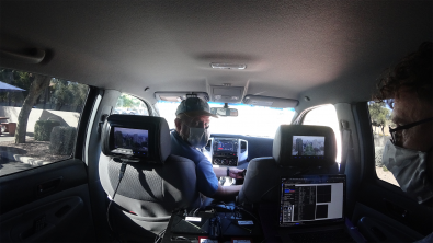 Sony engineer Luke Fay drives while passenger Graham Clift monitors reception. Courtesy Sony.