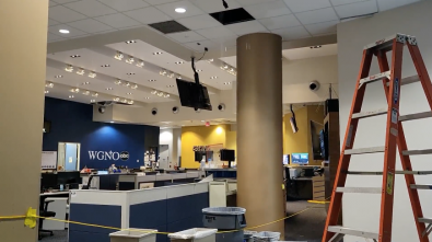 Water pours into the newsroom at WGNO-TV in Louisiana as staff continued to report during Hurricane Ida.