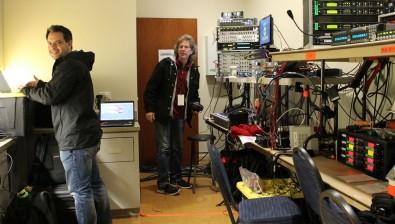 DirecTV colleague Alan Guzzy (left) and Hibbard prepare for a live radio remote broadcast.