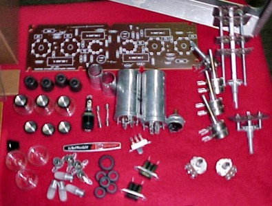 A bag of parts were laid out on a table.