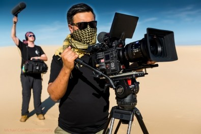 Clinton Harn, director/cinematographer, shooting with Sachtler tripod in the sand dunes of Australia.