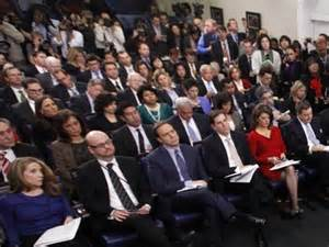 White House press corps listens and then questions the President in the typical press conference.