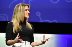 Analytics expert and NFL Network host Cynthia Frelund moderated the discussion and added a few insights about her use of AI algorithms to predict game outcomes. Photo courtesy of: Robb Cohen Photography & Video.