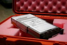 Digital Cinema Packages of feature films are typically delivered on hard drives. Trailers and ads can be moved on USB, DVD or Internet downloads. Image courtesy Digital Cinema Mastering.
