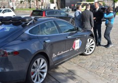 Politicians are interviewed before getting into the Tesla mobile studio.