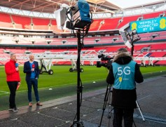 BT Sport's 5G remote production test with director of mobile strategy Matt Stagg (right),with presenter Matt Smith at Wembley Stadium.