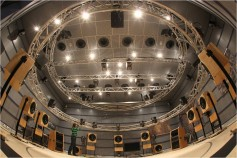 For years The Fraunhofer Institute has been experimenting with public theater systems with dozens of speakers in the same room that totally engulf the listener.