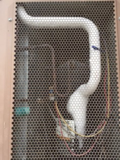 Basic HVAC: Icing like this indicates low Freon. Freon overpressure indicates a clogged condenser coil.