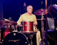 Tony Beard, the British drummer, at work. A single AEA A840, over Tony's shoulder, is picking up the entire drum kit.