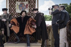 Damian Lewis as Henry VIII (seated), with cinematographer Gavin Finney (second right) and director Peter Kosminsky (far right).