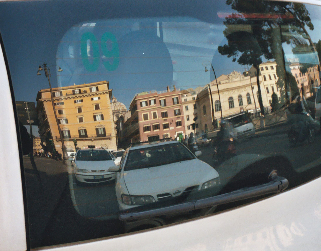 Figure 4b.<br />a) actress b) reflections in car window. While DOPs can benefit mostly from using a polarizer to shoot daylight exteriors, special care should be exercised when working with talent under bright conditions. The polarizing filter may improve an actor's skin tone by attenuating a portion of the sun's glare.  At the same time, the increased contrast may increase the visibility of blemishes, surface veins, and other defects, so a polarizer should always be used with care when shooting actors' close-ups. b) Polarizers may also reduce or eliminate helpful window reflections that add three-dimensionality to a scene. Don't kill reflections and highlights that enhance your visual story!